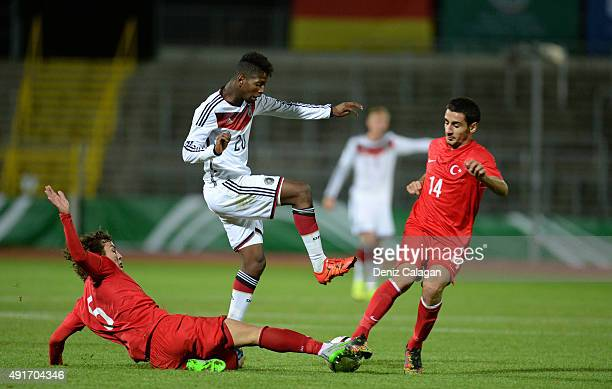 Boubacar Barry of Germany challenges Caglar Soeyuencue and Rahman Cagiran of Turkey on October 7 2015 in Ulm Germany