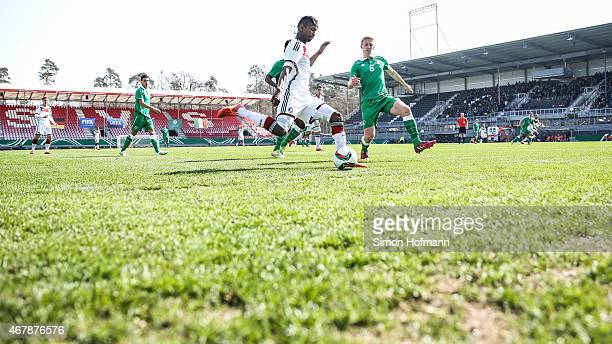 Boubacar Barry of Germany is challenged by Henry Charsley of Ireland during to the UEFA European Under19 Championship Elite Round match between U19...
