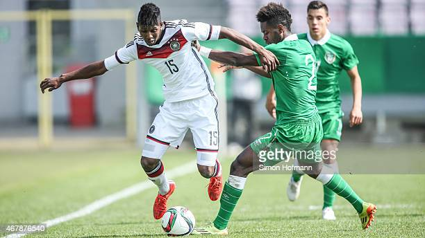 Boubacar Barry of Germany is challenged by Noe Baba of Ireland during to the UEFA European Under19 Championship Elite Round match between U19 Germany...