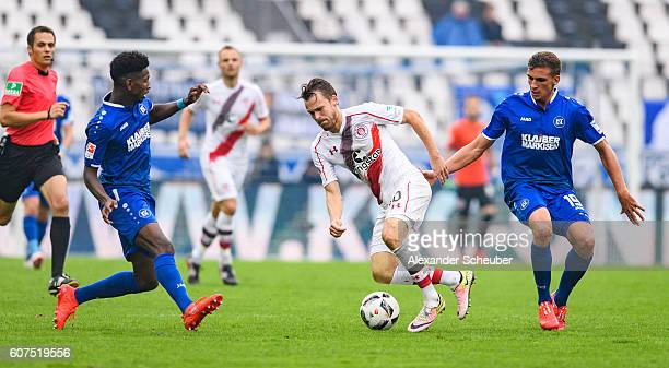 Boubacar Barry of Karlsruhe and Grischa Proemel of Karlsruhe challenges Christopher Buchtmann of St Pauli during the Second Bundesliga match between...