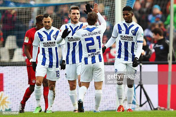 Boubacar Barry of Karlsruhe celebrates his team's first goal with team mates during a friendly match between Karlsruher SC and FC Bayern Muenchen at...