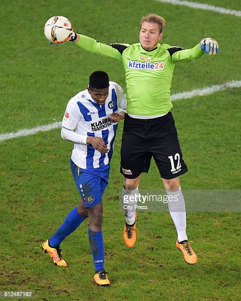 Boubacar Barry of Karlsruher SC and Jakob Busk of 1 FC Union Berlin during the game between Union Berlin and Karlsruher SC on February 26 2016 in...