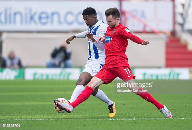 Boubacar Barry of Karlsruher SC challenges Denis Thomalla of 1 FC Heidenheimduring the second bundesliga match between Karlsruher SC and 1 FC...
