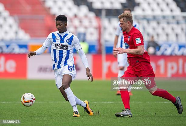 Boubacar Barry of Karlsruher SC challenges Marcel TitschRivero of 1 FC Heidenheim during the second bundesliga match between Karlsruher SC and 1 FC...
