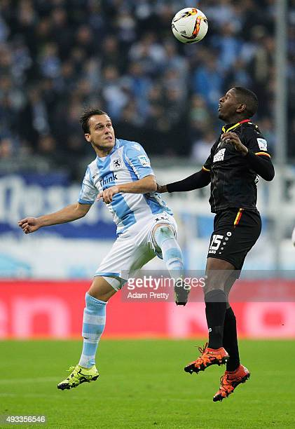 Boubacar Barry of Karlsruher SC challenges Michael Liendl of 1860 Munich during the 2 Bundesliga match between 1860 Muenchen and Karlsruher SC at...