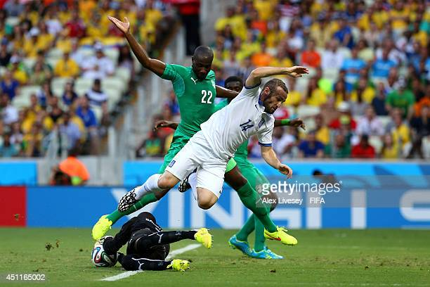 Boubacar Barry of the Ivory Coast makes a save while Dimitris Salpingidis of Greece tries to take a shot during the 2014 FIFA World Cup Brazil Group...
