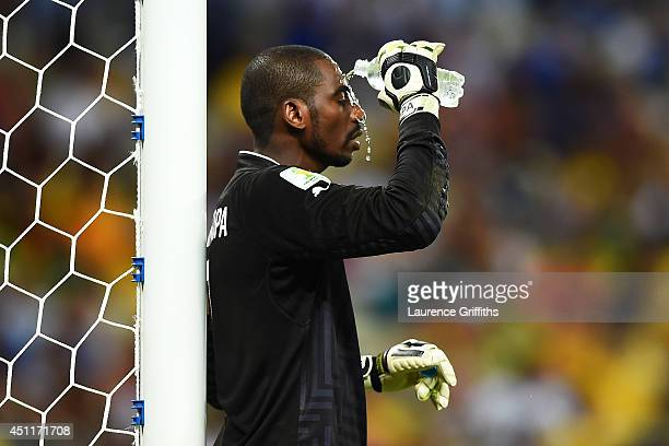 Boubacar Barry of the Ivory Coast pours water on his face during the 2014 FIFA World Cup Brazil Group C match between Greece and the Ivory Coast at...