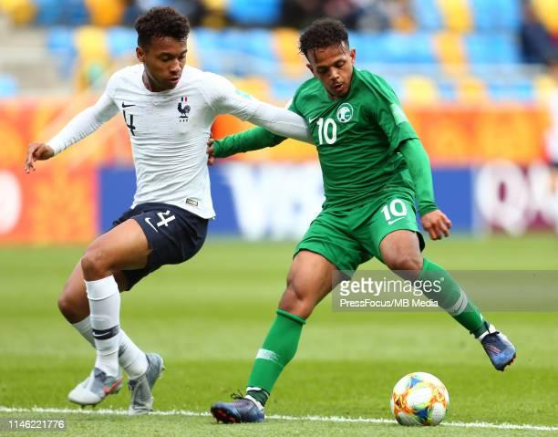 Boubacar Bernard Kamara of France tackles Turki Marwan S Alammar of Saudi Arabia during the FIFA U20 World Cup match between France and Saudi Arabia...