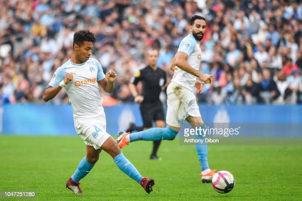 Boubacar Kamara and Adil Rami of Marseille during the Ligue 1 match between Marseille and Caen at Stade Velodrome on October 7 2018 in Marseille...
