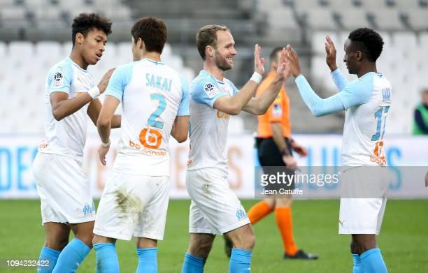 Boubacar Kamara Hiroki Sakai Valere Germain Bouna Sarr of Marseille celebrate the victory following the French Ligue 1 match between Olympique de...