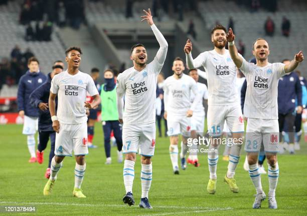 Boubacar Kamara, Nemanja Radonjic, Duje Caleta-Car, Valere Germain of Marseille celebrate the victory with the supporters following the Ligue 1 match...