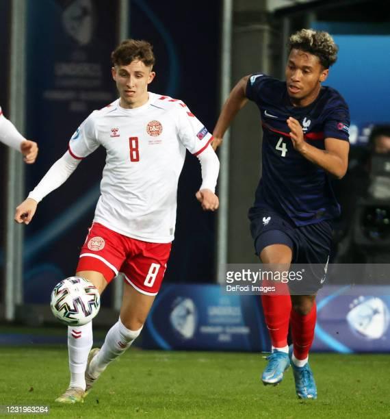Boubacar Kamara of France and Jesper Lindstroemof Denmark battle for the ball during the 2021 UEFA European Under-21 Championship Group C match...