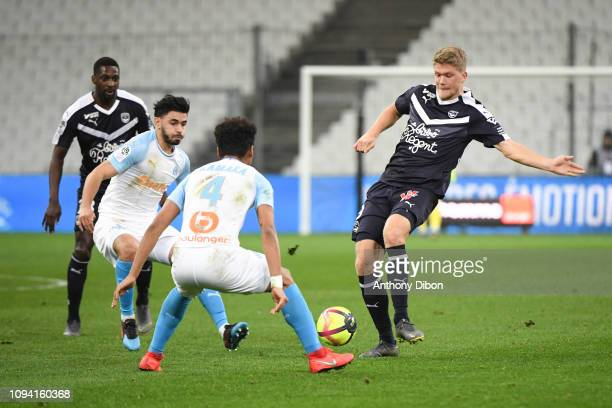 Boubacar Kamara of Marseille and Andreas Cornelius of Bordeaux during the Ligue 1 match between Marseille and Bordeaux at Stade Velodrome on February...