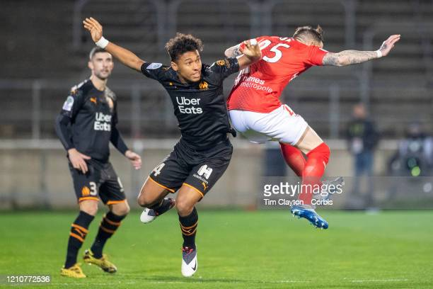Boubacar Kamara of Marseille and Nolan Roux of Nimes challenge for the ball during the Nimes V Marseille French Ligue 1 regular season match at Stade...