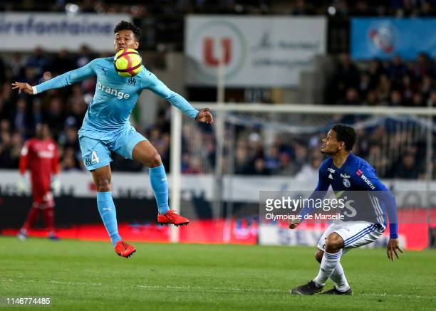 Boubacar Kamara of Olympique de Marseille jumps for the ball during the Ligue 1 match between RC Strasbourg and Olympique de Marseille at La Meinau...
