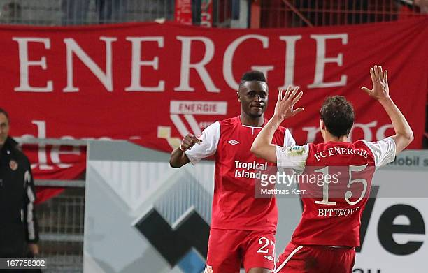 Boubacar Sanogo of Cottbus jubilates with team mate Alexander Bittroff after scoring the sixt goal during the Second Bundesliga match between FC...
