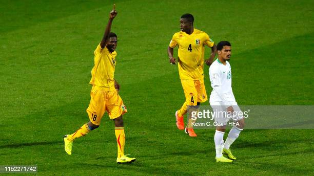 Boubacar Traore of Mali celebrates past Salem Alsaleem of Saudi Arabia after scoring his team's fourth goal during the 2019 FIFA U-20 World Cup group...