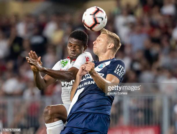 BoubacarTraore battles for the ball in the air with Zsombor Nagy of MTK Budapest during the Hungarian OTP Bank Liga match between MTK Budapest and...