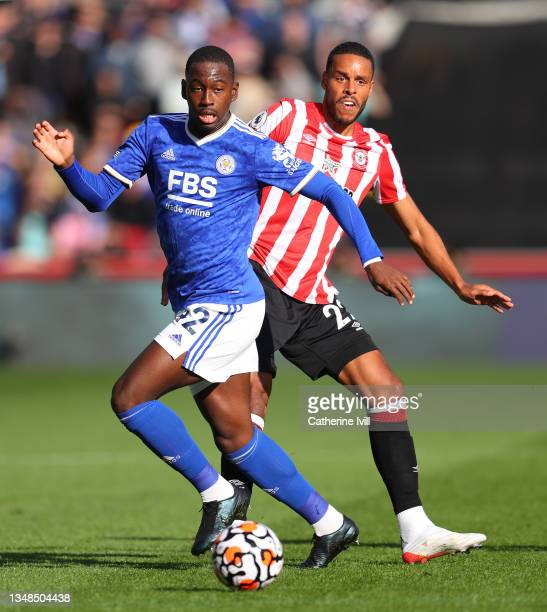 Boubakary Soumare of Leicester City is challenged by Mathias Zanka Joergensen of Brentford during the Premier League match between Brentford and...