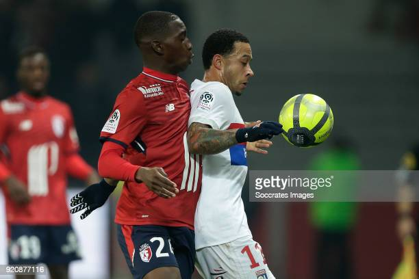 Boubakary Soumare of Lille Memphis Depay of Olympique Lyon during the French League 1 match between Lille v Olympique Lyon at the Stade Pierre Mauroy...
