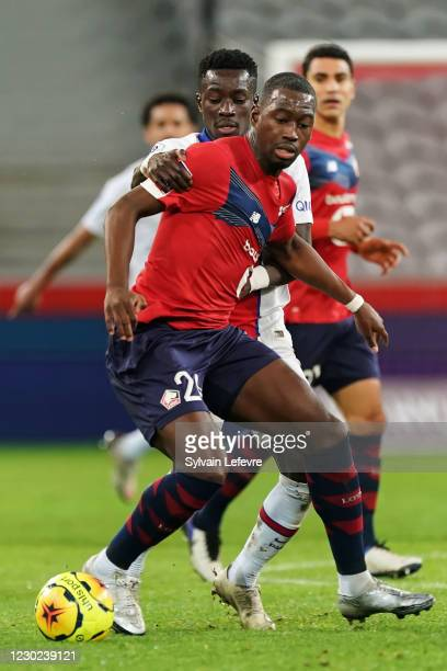 Boubakary Soumare of Lille OSC is challenged by Idrissa Gueye of Paris SG during the Ligue 1 match between Lille OSC and Paris Saint-Germain at Stade...