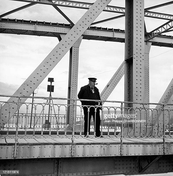 BouchesDuRhones Martigues A Man Smokes His Pipe On A Bridge
