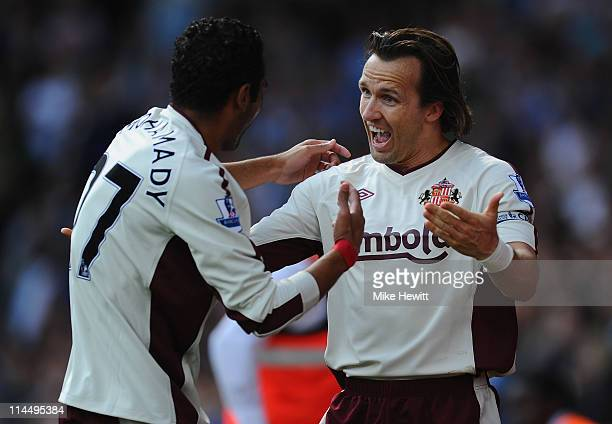 Boudewijn Zenden of Sunderland celebrates with team mate Ahmed Elmohamady after scoring during the Barclays Premier League match between West Ham...
