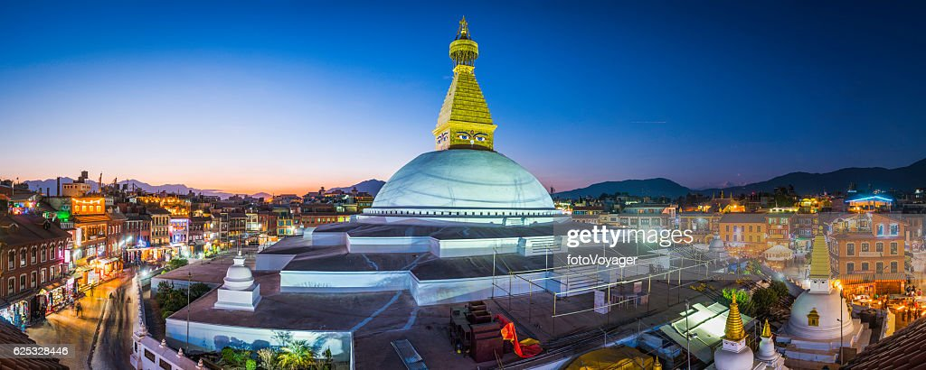 Boudhanath Stupa iconic Buddhist temple illuminated at sunset Kathmandu Nepal : Stock Photo