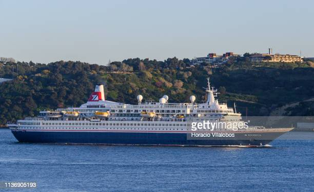 Boudicca a luxury cruise ship owned and operated by Fred Olsen Cruise Lines sails the Tagus River while leaving harbor on her way to Vigo Spain at...