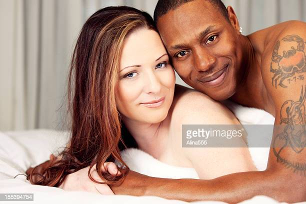 Boudoir portrait of a bi-racial couple