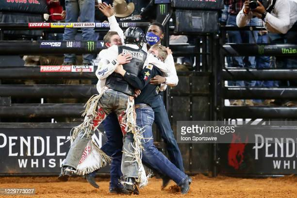 Boudreaux Campbell celebrates with Jess Lockwood and Ezekiel Mitchell during the PBR World Finals, on November 15th at the AT&T Stadium, Arlington,...
