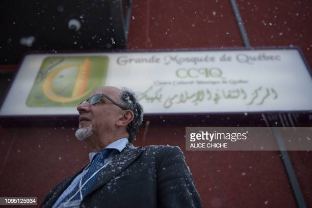 Boufeldja Benabdallah president and cofounder of the Islamic Cultural Center of Quebec talks to the press after a meeting with Canadian Prime...