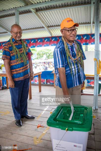 Bougainville regional president John Momis casts his ballot in an historical independence vote as the Papua New Guinea minister for Bougainville...