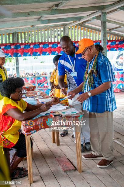 Bougainville regional president John Momis prepares to cast his ballot in an historical independence vote in Buka on November 23 2019 Voters in the...