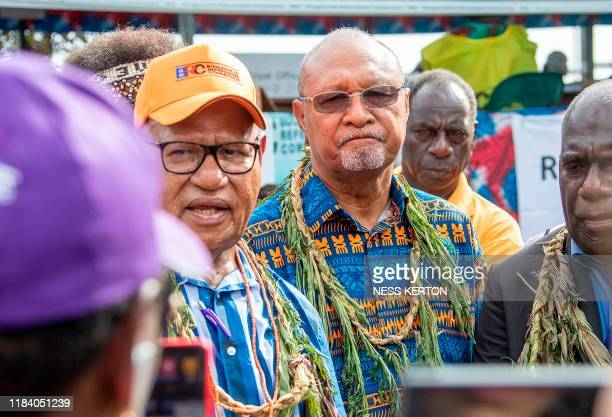 Bougainville regional president John Momis speaks to the media before casting his ballot in an historical independence vote as the Papua New Guinea...