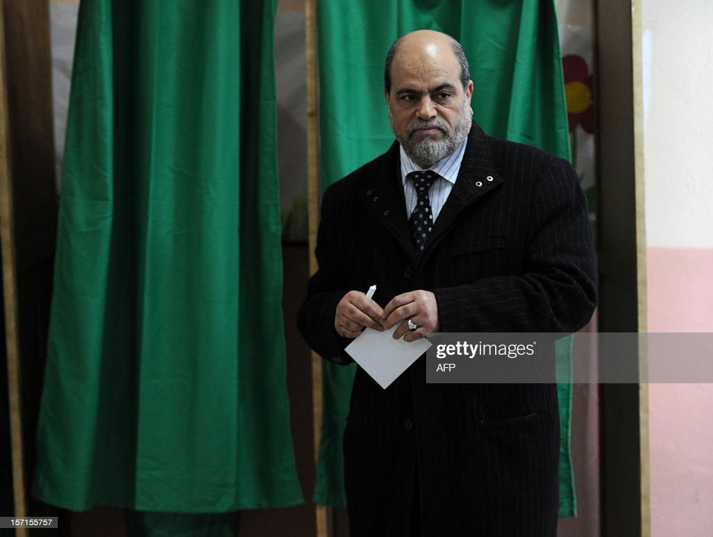 Bouguerra Soltani, leader of the Movement for a Society of Peace (MSP), from the Algerian branch of the Muslim Brotherhood, leaves a voting booth at a polling station in Algiers during municipal and regional assemblies elections on November 29, 2012. Algeria's ruling party, National Liberation Front (FLN), is eyeing a landslide victory in local elections, with numerous opposition groups warning of fraud in a poll that could struggle to mobilise a disaffected electorate.