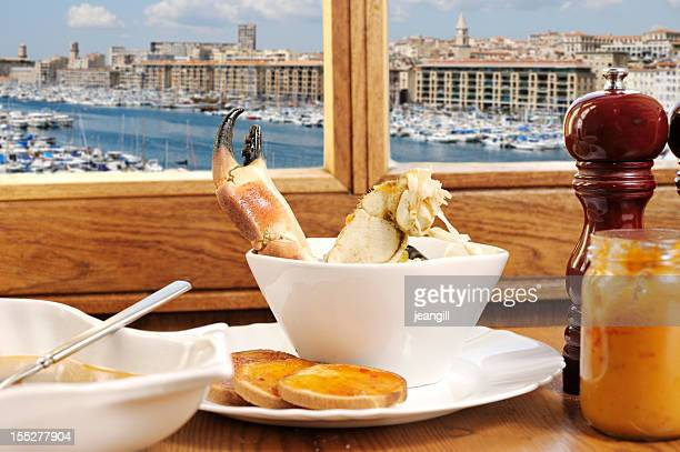 bouillabaisse with view of marseille - marseille stock pictures, royalty-free photos & images