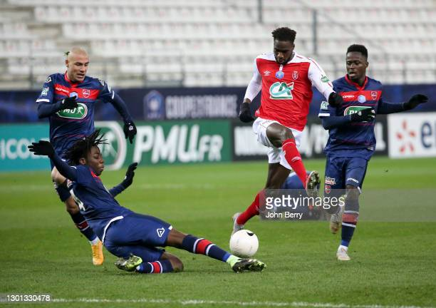 Boulaye Dia of Reims between Ismael Doukoure, Jaba Kankava and Emmanuel Ntim of Valenciennes during the French Cup match between Stade Reims and...