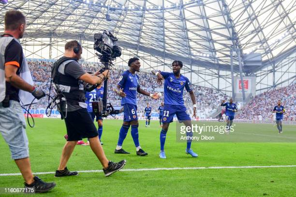 Boulaye Dia of Reims celebrates a goal during the Ligue 1 match between Marseille and Reims at Stade Velodrome on August 10 2019 in Marseille France