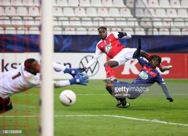 Boulaye Dia of Reims, Ismael Doukoure of Valenciennes, goalkeeper of Valenciennes Hillel Konate during the French Cup match between Stade Reims and...