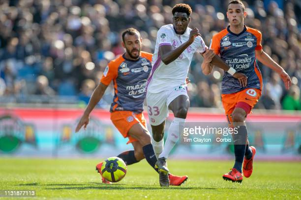 Boulaye Dia of Stade de Reims defended by Ellyes Skhiri of Montpellier and Hilton of Montpellier during the Montpellier Vs Stade de Reims French...