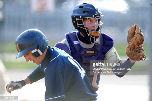 Boulder catcher John Crook shows the ball to the umpire after tagging Mullen's Adrian Schenk out at home at Scott Carpenter Park in Boulder on...