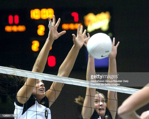 SEPTEMBER 9 2004 / Boulder CO / University of Colorado's Allie Griffin left and Austin Zimmerman try and block a shot by the University of Pittsburgh...