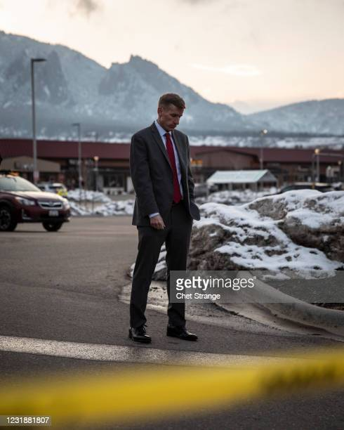 Boulder County District Attorney Michael Dougherty takes a moment to himself before addressing the media after a gunman opened fire at a King...