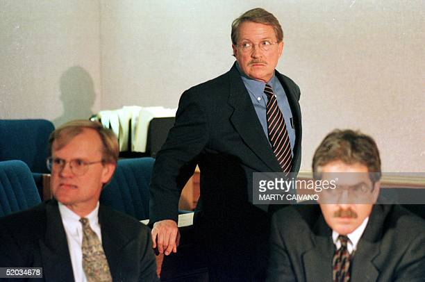Boulder District Attorney Alex Hunter is pictured with detective Tom Wickman and special prosecutor Bruce Levin during a news conference at the...