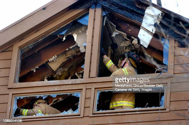 Boulder Fire Rescue Lt. Brian Eckelkamp , right, examines a section of ceiling as engineer Frank DeCoteau moves debris nearby in the Gold Run...