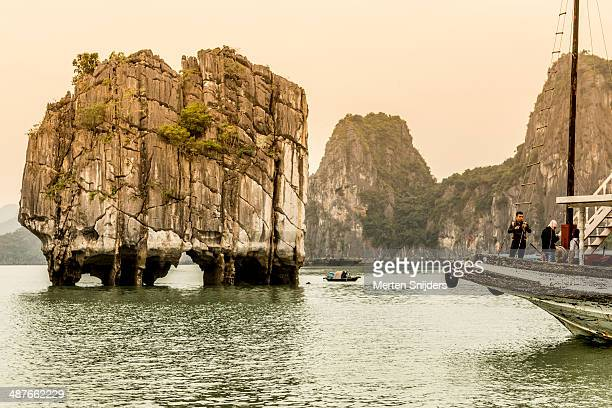 boulder rock above water in ha long bay - merten snijders bildbanksfoton och bilder