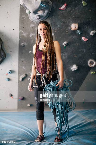Bouldering climber portrait looking at camera in the gym.