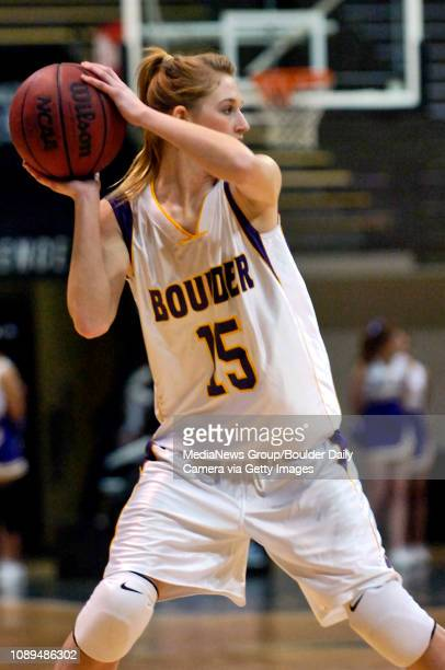 Boulder's Allie Hooson looks for an opening in the Fairview defense in the first half at the Coors Events Center in Boulder on Thursday