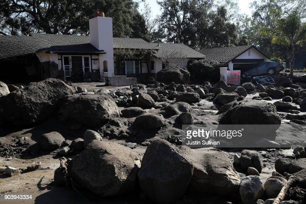 Boulders and mud stand in front of a home that was destroyed by a mudslide on January 11 2018 in Montecito California 17 people have died and...
